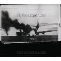 1950 Press Photo Amer C 54 transport burns Korea war