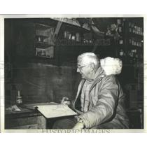 1962 Press Photo Sir Charles Seymour Wright Finishes Paper Work In Antarctica
