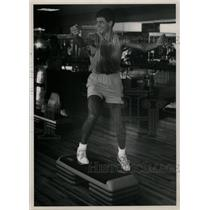 Press Photo Step Aerobics extreme popular men Exercise - RRW74773