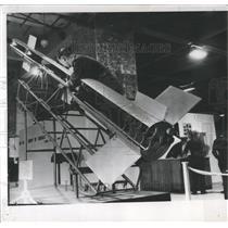 1952 Press Photo Warrant Bridge Adjusts Rocket Model