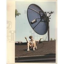 1991 Press Photo Sharon Bussell On Roof With Huge Satellite - RSC68843
