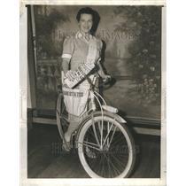 1942 Press Photo Woman Newsboy War Times Bicucle