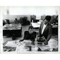 1991 Press Photo Michigan Chronicle Employees Proofing - RRW89985