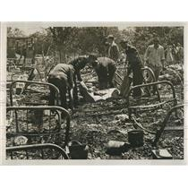 1953 Press Photo Men cleaning up after fire.