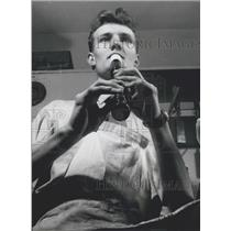Press Photo Young Apprentice Of Instrument Making Practicing Recorder