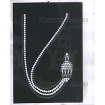 """1969 Press Photo White & black pearls & onyx ace blended in """"The Swag"""" by Dunay"""