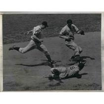 1943 Press Photo Indians Mike Rocco slides to 1st vs Yankees Bill Johnson