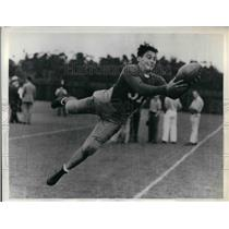 1935 Press Photo Alex Trompas practicing for his last collegiate game with