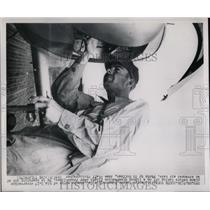 1950 Press Photo Lt George Rogers Working on His Plane