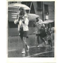 1955 Press Photo A Family Walking In The Rain