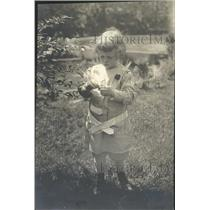 1919 Press Photo Child examines tree leaf - RRT64299