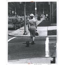1965 Press Photo Kercheval Stclair Carrying Woman Bag