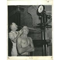 1937 Press Photo James C. Smith Taking Strength Test