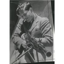 1942 Press Photo Boy Different Peasant Wanting Gun - RRT61185