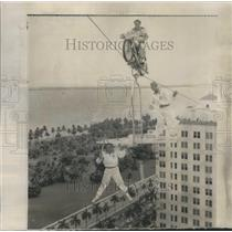 1954 Press Photo Aerialists Stunt Cable Between Hotels - RRS36745