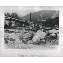 1954 Press Photo Boulders Mud Threaten Volunteer - RRS12279