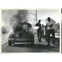Press Photo Volkswagan Car Fire Mars Passersby - RRS92155
