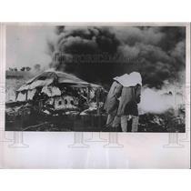 1951 Press Photo Firefighters quell blazing fuselage of B-29 Bomber - nea85512