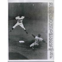 1957 Press Photo Chico Carrasquel goes high in the air, Eddie Yost slides