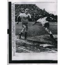 """1956 Press Photo """"Pee Wee"""" Reese, Dodger shortstop vs Yankee Bill Skowron"""