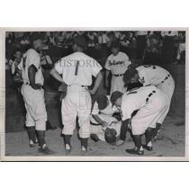 1952 Press Photo Dave Pope of Indians Lies On Ground After Hitting Wall, L. Doby