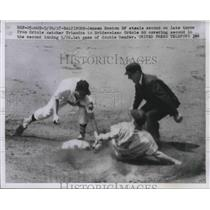 1957 Press Photo Jensen Boston of steal second from Oriole Catcher Triandos.