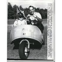 1961 Press Photo NY Yankees; Yogi Berra Gives Young Mickey Viall a Ride