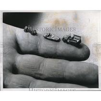 1959 Press Photo Tiny Foreign Cars Fit on Finger at Paris Miniature Car Show