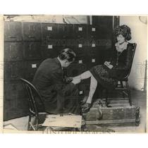 1924 Press Photo Peggy Blodgett purchasing new stockings from C Blogett