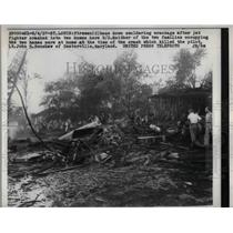 1957 Press Photo Firemen at fighter jet wreckage in St Louis, Mo - nem09796