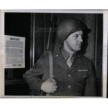1944 Press Photo Sgt.James Dies, guard over a sign for Montgomery Ward Employees