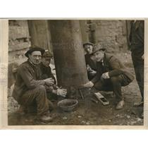 1923 Press Photo Men placing sticks of dynamite at base of blast furnace