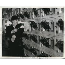 1938 Press Photo Miss Pitkin Takes Rat From Cage at Pitkin Rat Farm