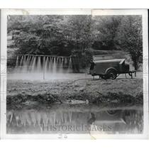 Press Photo Portable Irrigation with 24 jets of warm water