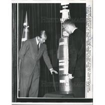 1957 Press Photo Dr. Newell showing a model of the Aerobee Hi research rocket