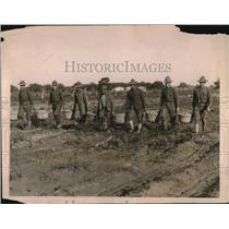 1918 Press Photo Farm Workers Carrying Harvest Baskets Through Mud