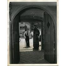 1938 Press Photo A man arrives at the St. Christopher Inn and greeted by a friar
