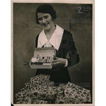 1923 Press Photo Miss Irene Poreslin & some merchandise kits