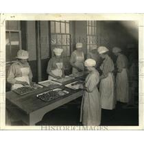 1919 Press Photo Girl employees trimming fat off fresh glands