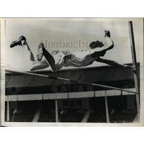 1938 Press Photo J.C. Adams on high jump competition
