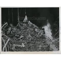 1951 Press Photo Small fire burns from plane wreckage United Airl Lines; 11 died