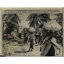 1958 Press Photo Indonesian Women Carry Belongings on Heads Fleeing Sumatra
