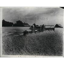 1933 Press Photo new combine 1/2 size of old one in wheat fields in Midwest soon