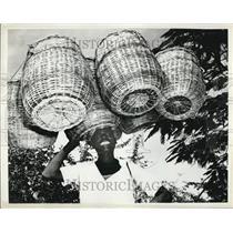 Press Photo Basket Vendor In Haiti