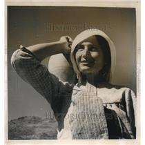 1949 Photo Archangelo woman with her handmade water jug fetches well water