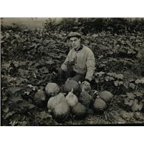 1930 Press Photo 4-H Club member who has selected gardening a squash