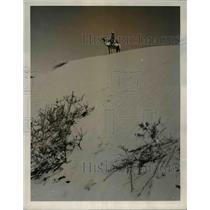 1939 Press Photo A camel policeman atop the sand dune of Kalahari