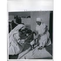 1957 Press Photo Baby Fed Milk at UNICEF Holy Family Mission Hospital, Pakistan