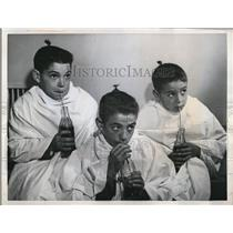 1959 Press Photo of the Rodriguez brothers drinking their soda sporting