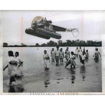 1954 Press Photo Indian school kids returning home in flooded field, Assam India